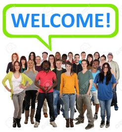 42709125-Large-multi-ethnic-group-of-smiling-young-people-with-word-welcome-Stock-Photo